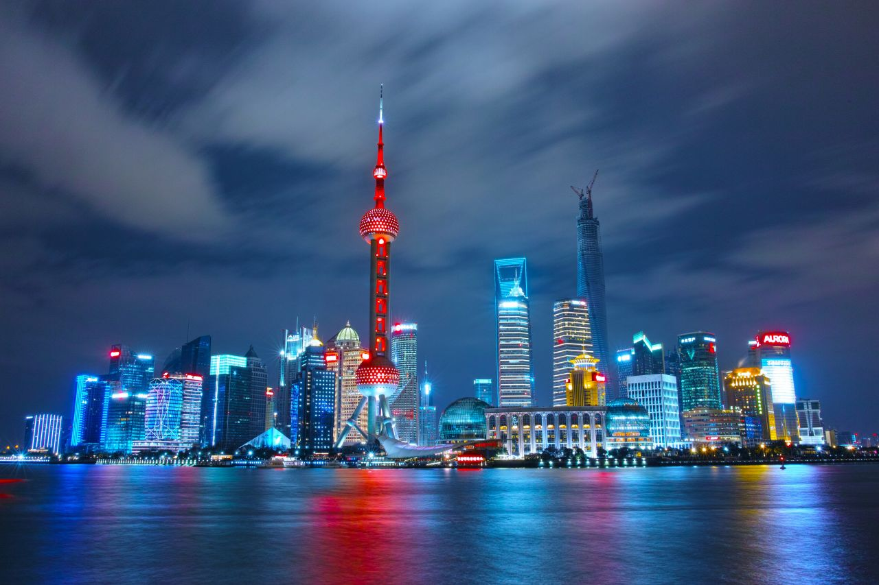 China---Shanghai-night-skyline-with-bright-lights-in-shanghai-china